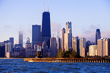 Skyscrapers and historical lighthouse seen from Lake Michigan, Chicago, Illinois