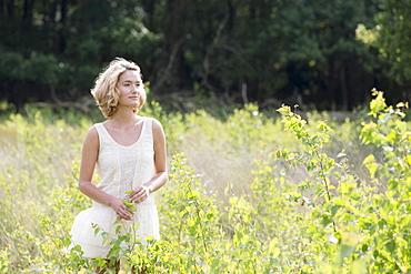 Woman relaxing on meadow, Netherlands, Gelderland, Hatertse Vennen