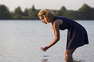 Beautiful woman in lake, Netherlands, Gelderland, De Rijkerswoerdse Plassen