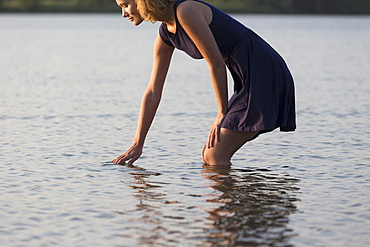 Beautiful woman in lake