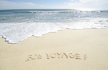 Bon Voyage' note on sand