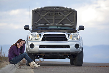 Woman calling for assistance after vehicle breakdown, Whitefish, Montana, USA