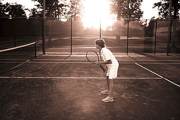 Boy playing tennis, Texarkana, AR
