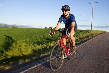 USA, Montana, Kalispell, Cyclist captured in motion, USA, Montana, Kalispell