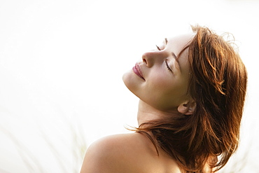 Portrait of young woman in strong sunlight