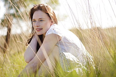 Young woman relaxing on meadow