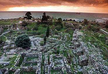 Ruins of ancient Greek city at sunset