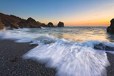 Blurred surf wave washing ashore