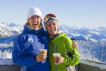 USA, Montana, Whitefish, Portrait of two women with mountains as backdrop