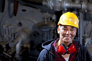 Portrait of male manual worker wearing hardhat