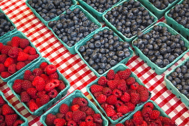 Raspberries and blueberries in cartons