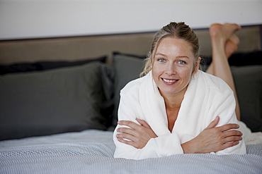 Portrait of mature woman lying on bed