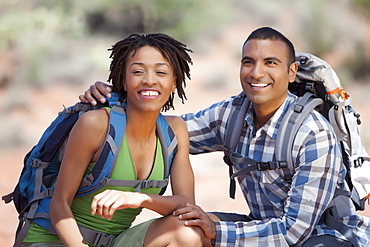 Young couple hiking and enjoying desert scenery