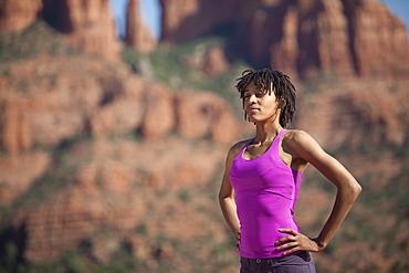 USA, Arizona, Sedona, Young woman standing at desert