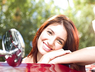 Smiling young woman in convertible car