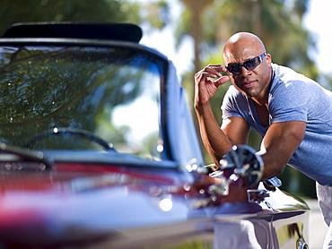 Mature man near classic's car