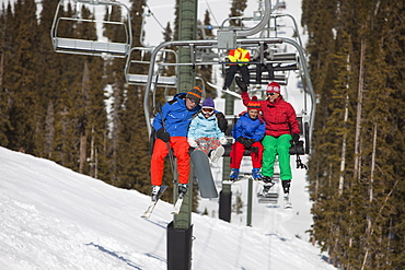 USA, Colorado, Telluride, Family on ski lift