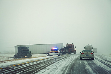 USA, Illinois, Springfield, Semi truck accident on highway during storm