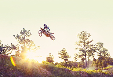 USA, Texas, Austin, Dirt bike jumping