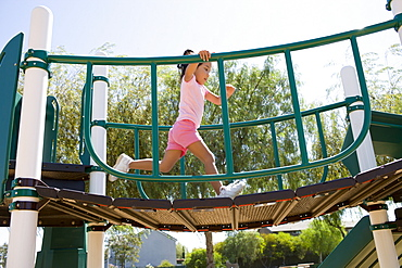USA, California, Girl (4-5) playing in playground