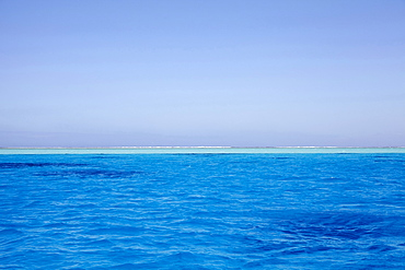 Clear sky above blue rippled sea, French Polynesia, Raiatea