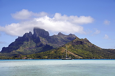 Sailboat with islands at background, French Polynesia, Bora Bora