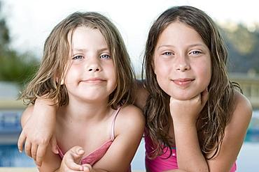 Spain, Costa Blanca, Two girls (6-7,8-9) embracing
