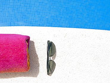 Spain, Costa Blanca, Sunglasses and towel