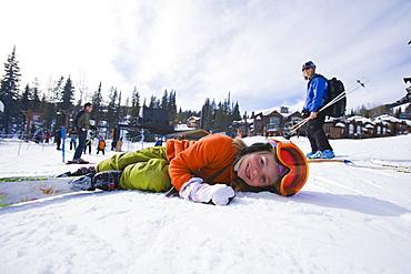 USA, Montana, Whitefish, Girl (8-9) skiing with her mother