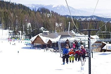 USA, Montana, Whitefish, Family on ski lift