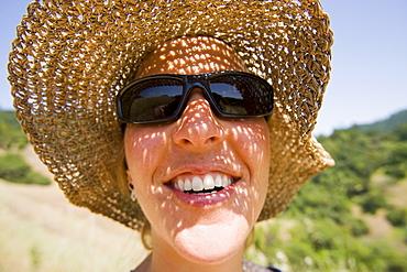 USA, California, Woman wearing straw hat