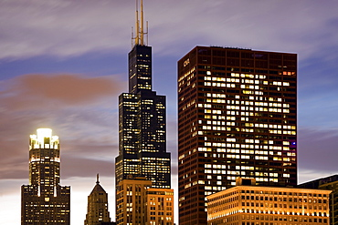 USA, Illinois, Chicago, Illuminated skyscrapers at dusk