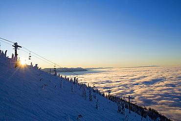 USA, Montana, Whitefish, Ski lift on mountain over clouds