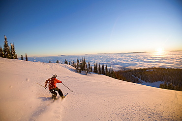 USA, Montana, Whitefish, Mid adult man skiing