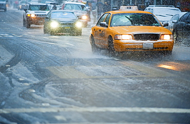 USA, New York, New York City, Traffic on street in snow