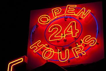 Illuminated open 24 hours sign