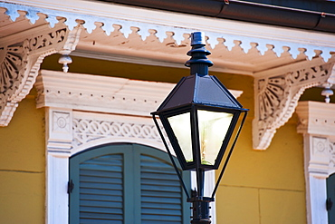 Lamp post in front of house in French Quarter of New Orleans
