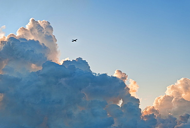 Clouds and airplane