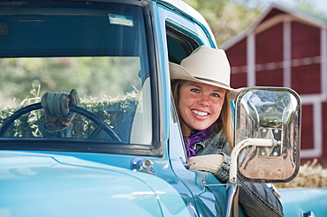 Cowgirl driving truck
