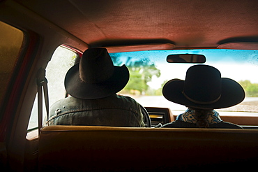 Cowboy and cowgirl in truck