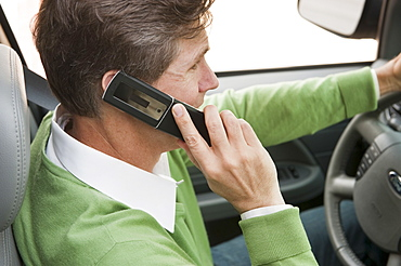 Man using cellular phone while driving