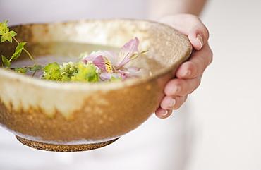 Woman holding aromatherapy bowl