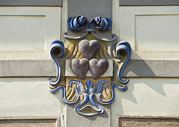 Close up of heart emblem on house
