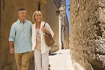 Tourists walking in alley
