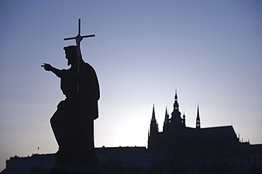 Silhouetted statue and cathedral