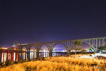 View of arch bridge at night, Newport, Oregon