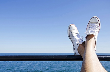 Man's feet on ferry boat, Massachusetts, USA