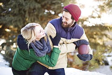 Couple playing American football, Salt Lake City, Utah