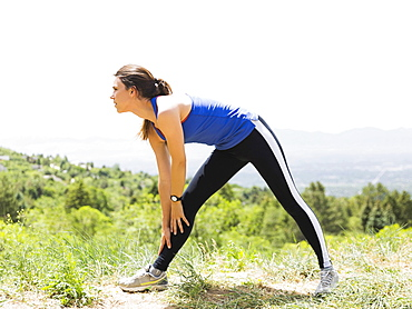 Female jogger stretching, USA, Utah, Salt Lake City