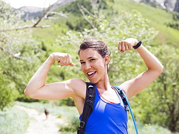 Portrait of athletic woman flexing muscles, USA, Utah, Salt Lake City